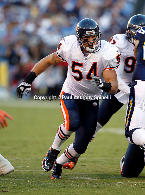 Chicago Bears linebackers Brian Urlacher (54) chases the ball carrier during a NFL week 1 preseason football game against the San Diego Chargers, Saturday, August 14, 2010 in San Diego, California. The Chargers won the game 25-10. (©Paul Anthony Spinelli)