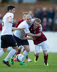 Raith Rovers Martin Scott holds Linlithgow Rose Blair Batchelor.<br /> Half time : Linlithgow Rose 0 v 0 Raith Rovers, William Hill Scottish Cup Third Round game player today at Prestonfield.