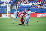 FC Dallas Forward Dominique Badji (14) blocks out NYCFC defender Eric Miller(5) while teammate Alexander Ring (8) look on during a MLS soccer game, Sunday, Sept. 22, 2019, in Frisco, Tex. FC Dallas and New York FC draw 1-1 (Wayne Gooden/Image of Sport)