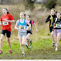 23 February 2014; Emily Cahill, St. Cronans A.C, Co. Clare, left, and Sara Doyle, St. Laurence O'Toole A.C, Co. Carlow, in action in the Under 13 Girls 1500m race during the Woodie's DIY Intermediate, Master & Juvenile Development Cross Country Championships of Ireland. Cow Park, Dunboyne, Co. Meath. Picture credit: Ramsey Cardy / SPORTSFILE