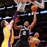 19 March 2014: San Antonio Spurs forward Kawhi Leonard (2) goes for the layup past Los Angeles Lakers center Pau Gasol (16) and Los Angeles Lakers forward Wesley Johnson (11) during the San Antonio Spurs 125-109 victory over the Los Angeles Lakers at the Staples Center, Los Angeles, California, USA.