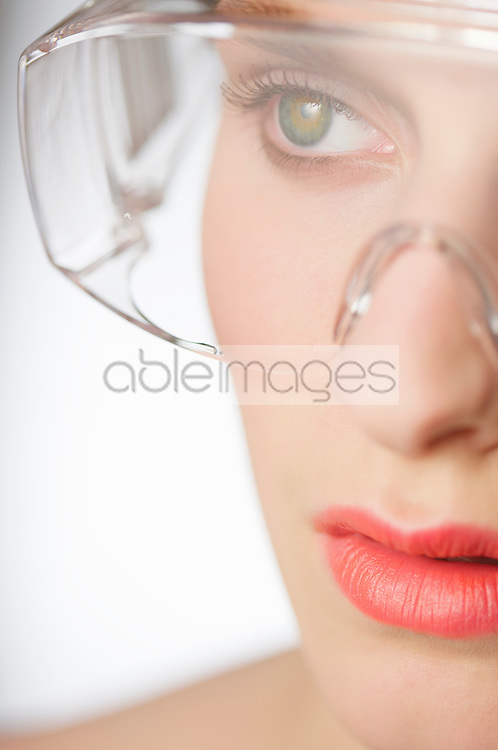 Close up of a young woman wearing safety glasses