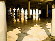 06 JUNE 2015 - KUALA LUMPUR, MALAYSIA: One of the prayer areas of the Masjid Jamek Built in 1909, Jamek Mosque is one of the oldest mosques in Kuala Lumpur. It is located at the confluence of the Klang and Gombak River and was designed by Arthur Benison Hubback. The mosque was a built in the style of Mughal (northern India) architecture. Before the national mosque, Masjid Negara, was opened in 1965, Masjid Jamek served as Kuala Lumpur's main mosque.      PHOTO BY JACK KURTZ