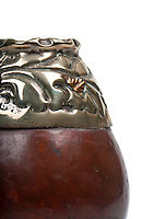 Close up of calabash cup for mate, top hand carved in silver and gold. Mate is a traditional drink very similar to tea in Argentina, Uruguay, Paraguay and some parts of Brazil.