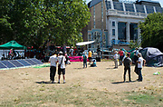 Extinction Rebellion on day 2 of their activities in central London, their blue boat opposite the Old Vic theatre near Waterloo and their encampment on Waterloo Millennium Green at the end of Lower Marsh, London, Great Britain <br />