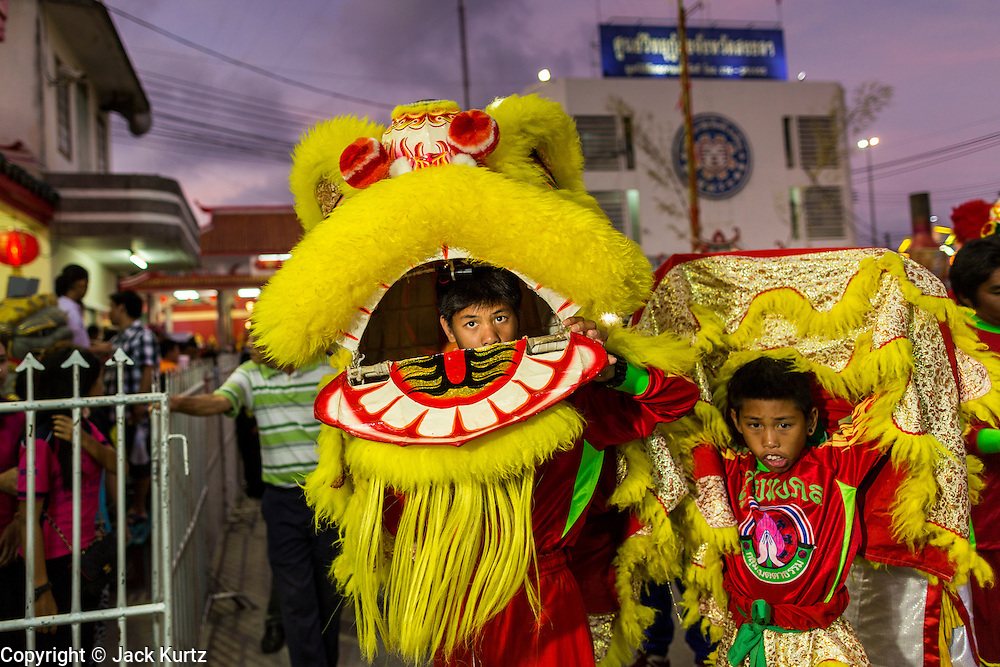 06 FEBRUARY 2014 - HAT YAI, SONGKHLA, THAILAND: A Lion Dance performance in the Tong Sia Siang Tueng temple in Hat Yai. Hat Yai was originally settled by Chinese immigrants and still has a large ethnic Chinese population. Chinese holidays, especially Lunar New Year (Tet) and the Vegetarian Festival are important citywide holidays.     PHOTO BY JACK KURTZ