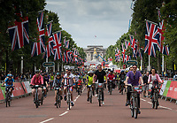 A view of the riders as they cycle up The Mall overlooking Buckingham Palace as part of the  Prudential RideLondon FreeCycle 29/07/2017<br />