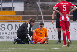 East Fife's keeper Brett Long hurt after a tackle with Forfar Athletic's Jamie Bain . Forfar Athletic 3 v 0 East Fife, Scottish Football League Division One game played 2/3/2019 at Forfar Athletic's home ground, Station Park, Forfar.