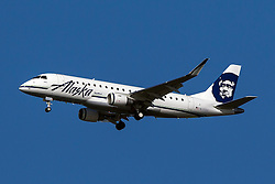 Alaska Airlines Skywest Embraer ERJ170-200LR (registration N175SY) approaches San Francisco International Airport (SFO) over San Mateo, California, United States of America