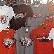 Scrap Yard Dawgs t-shirts hang for sale in a lone souvenir tent.<br /> <br /> Todd Spoth for The New York Times.