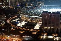 Olympiysky stadium at night, bird view. Kyiv, Ukraine. This is the place where Euro-2012 soccer games took place. Shot on the day of soccer game, with all light on.<br /> <br /> Вечерний снимок Республиканского стадиона в Киеве. Детали элементов освещения.
