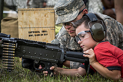 Apr 29, 2017 - Eglin Air Force Base, Florida, U.S. - Little Ranger. A soldier talks with a child about a machine gun during the 6th Ranger Training Battalion's open house event at Eglin Air Force Base, April 29, 2017. The event provided an opportunity for the public to learn how Rangers train and operate. (Credit Image: ? Samuel King/Air Force/DoD via ZUMA Wire/ZUMAPRESS.com)