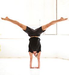 Man Practicing Yoga, Handstand