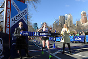 Donnie Jack, left, Scottish Affairs Counsellor for the Americas, and Kate Perkins, Second Secretary for Scottish Affairs, hold the tape as Megan Hogan, of New York, is the first female finisher at the 12th annual Scotland Run in New York's Central Park, Saturday, April 4, 2015, as part of Scotland Week.  (Photo by Diane Bondareff/Invision for Scottish Government/AP Images)