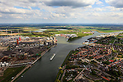 Nederland, Zeeland, Zeeuws-Vlaanderen, 09-05-2013; cruiseschip op Kanaal Gent-Terneuzen, ter hoogte van Sluiskil. Gezien naar Sas van Gent. Links stikstofbindingsbedrijf Yara, fabricage van kunstmest, ammoniak, ureum, salpeterzuur, CO2 (kooldioxide).<br /> Cruise ship on the Gent-Terneuzen canal in the south of the province Zeeland. Yara, nitrogen compound company manufactures fertilizer, ammonia, urea, nitric acid, CO2 (carbon dioxide) <br /> luchtfoto (toeslag op standard tarieven)<br /> aerial photo (additional fee required)<br /> copyright foto/photo Siebe Swart