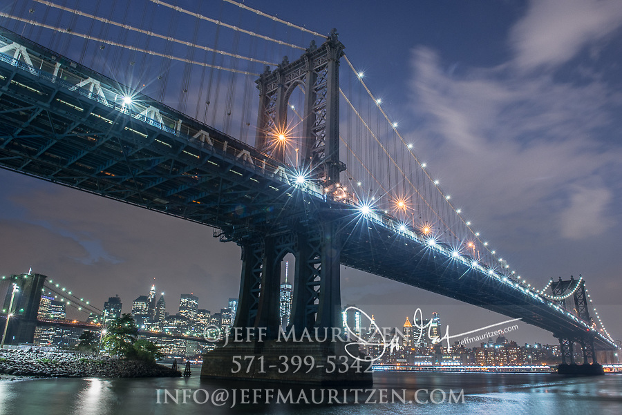 Nighttime at the Manhattan Bridge. a suspension bridge that spans the East River and connects Brooklyn with Manhattan, NYC.
