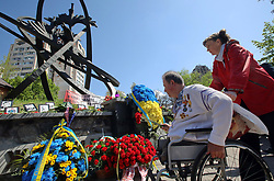 April 26, 2018 - Kyiv, Ukraine - A man in a wheelchair lays flowers at the Memorial Complex 'Monument to the Victims of the Chornobyl Tragedy' during a tribute-paying ceremony on the 32nd anniversary since the accident at the fourth reactor of the Chornobyl (Chernobyl) Nuclear Power Plant in Kyiv, capital of Ukraine, April 26, 2018. Ukrinform. (Credit Image: © Tarasov/Ukrinform via ZUMA Wire)
