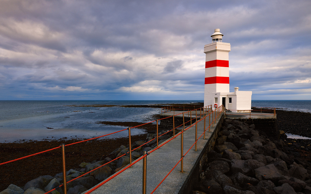 The old Garðskagi Lighthouse was built in 1897 and was used until recently as a centre for studying the thousands of migrating birds which arrive there from Greenland and North America every year to breed on the surrounding shore. It was once regarded as one of the best lighthouses in Iceland because it stood low and therefore mist was not a problem. Although there was risk of the lighthouse being damaged because of surf and it was sometimes not visible because of seastorm.