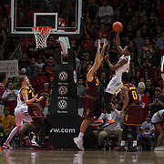 10 December 2016: The San Diego State Aztecs men's basketball team host's Saturday afternoon at Viejas Arena. San Diego State forward Malik Pope (21) attempts a fade away jump shot over an Arizona State defender in the first half. The Aztecs lead the Sun Devils 32-25 at half time. www.sdsuaztecphotos.com