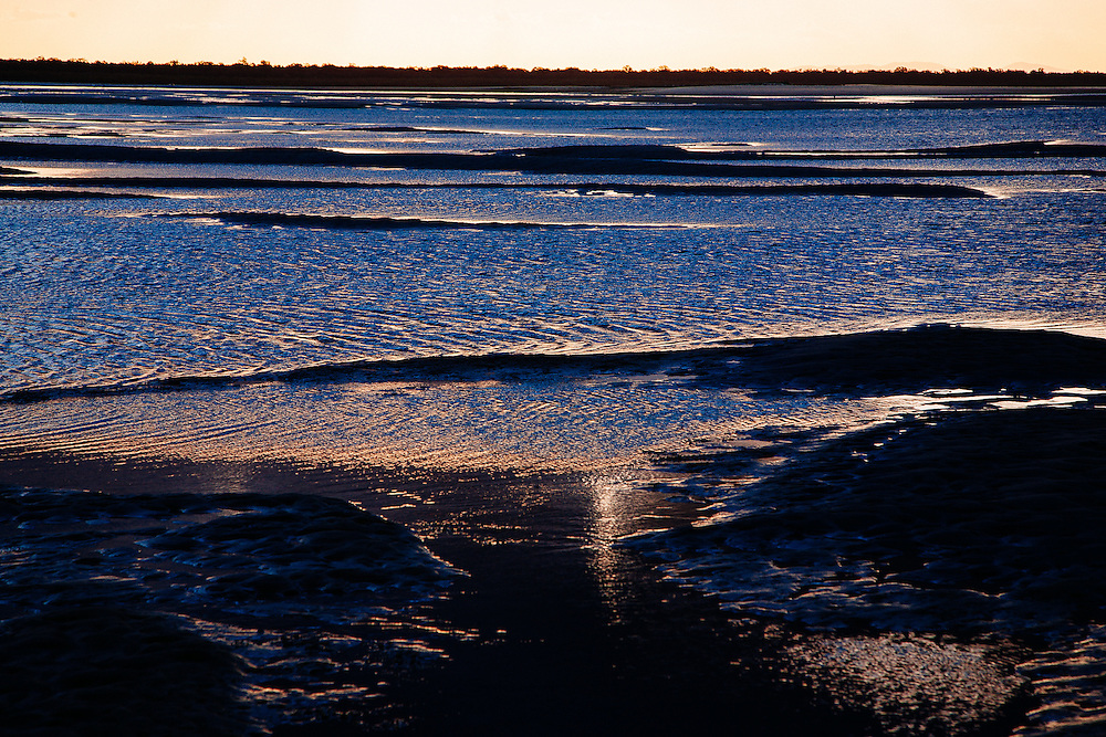 Tidal flats at sunset in the Inskip Point Recreation Area.