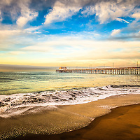 Photo of Newport Pier on Balboa Peninsula in Newport Beach. Newport Beach is a wealthy beach community along the Pacific Ocean in Orange County Southern California.