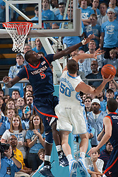 07 February 2009: Virginia Cavaliers center Assane Sene (5) defends North Carolina forward Tyler Hansbrough (50) during a 76-61 loss to the North Carolina Tar Heels at the Dean Smith Center in Chapel Hill, NC.