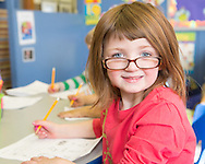 Promotional pictures for a local school, engaged child working,
