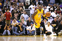 28 December 2005: Guard Kobe Bryant of the Los Angeles Lakers dribbles the ball up the court after a rebound against the Memphis Grizzlies during the 4th period of the Grizzlies 100-99 victory over the Lakers at the STAPLES Center in Los Angeles, CA.