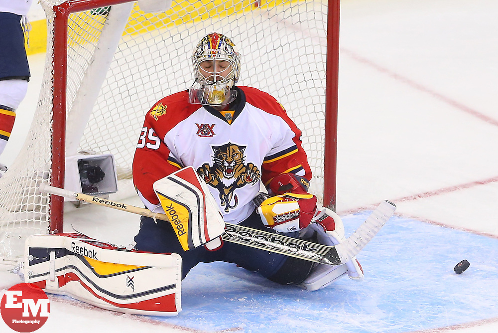 Mar 31, 2014; Newark, NJ, USA; Florida Panthers goalie Dan Ellis (39) reacts after a goal by New Jersey Devils center Travis Zajac (19) (not shown) during the third period at Prudential Center. The Devils defeated the Panthers 6-3.