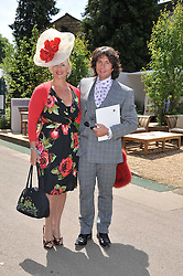 LAURENCE LLEWELYN-BOWEN and his wife JACKIE at the 2011 RHS Chelsea Flower Show VIP & Press Day at the Royal Hospital Chelsea, London, on 23rd May 2011.