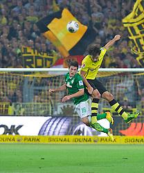 23.08.2013, Signal Iduna Park, Dortmund, GER, 1. FBL, Borussia Dortmund vs SV Werder Bremen, 3. Runde, im Bild Zlatko Junuzovic (Bremen #16) im Kopfballduell mit Mats Hummels (BVB Borussia Dortmund #15) // duringthe German Bundesliga 3rd round match between Borussia Dortmund and SV Werder Bremen at the Signal Iduna Park, Dortmund, Germany on 2013/08/23. EXPA Pictures &copy; 2013, PhotoCredit: EXPA/ Andreas Gumz <br /> <br /> ***** ATTENTION - OUT OF GER *****