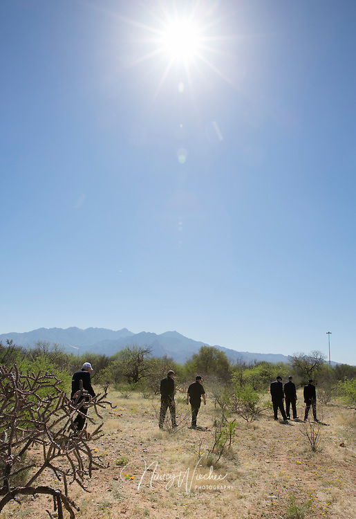 A hot morning sun beats down as a group of U.S. bishops walks the Arizona desert about 30 miles north of Nogales March 31. Nine bishops took part in a two-day tour focussed on border issues in Nogales. They used the opportunity to again appeal for changes in the U.S. immigration system. (CNS photo/Nancy Wiechec) (April 1, 2014)