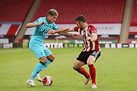 Football - 2019 / 2020 Premier League - Sheffield United vs Tottenham Hotspur<br /> Erik Lamela of Tottenham Hotspur and Enda Stevens of Sheffield United, at Bramall Lane.<br /> <br /> COLORSPORT/PAUL GREENWOOD