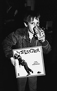 A young boy holding a Selecter album, drinking Coka Cola, Ska, 2Tone, Coventry, UK 1980