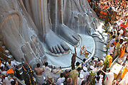 Jain devotees at the foot of gomateshvara bahubali statue, Shravanbelagola, Hassan, Karnataka, India