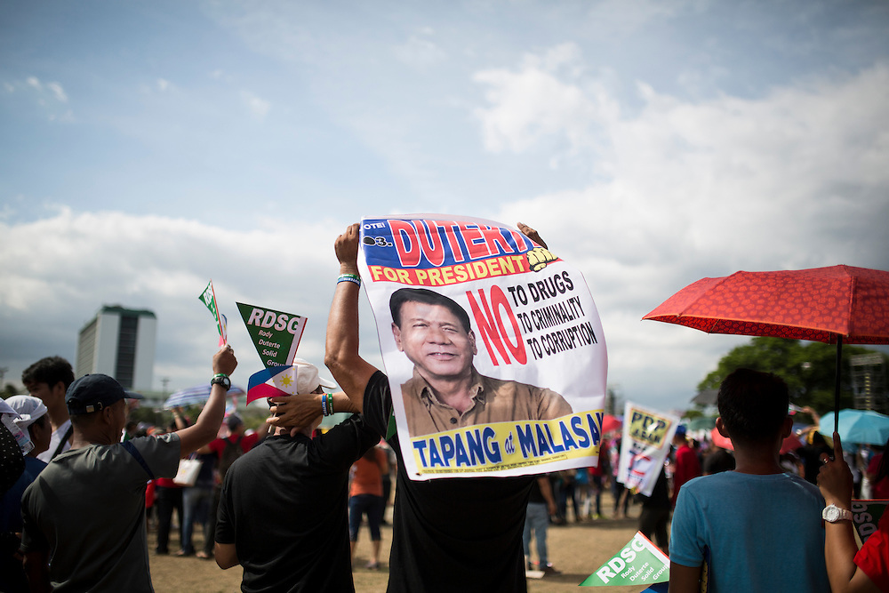 MANILA, PHILIPPINES - MAY 7: A supporter holding a poster of Mayor Rodrigo &quot;Digong&quot; Duterte saying No to Drugs, No to criminality, No to corruption, while waiting for meeting de Avance in Luneta Grand Stand, Manila, Philippines on Saturday, May 7, 2016. Rodrigo &quot;Digong&quot; Duterte runs for president in the 2016 Philippine national election that  will be held on May 9, 2016.<br /> <br /> Photo by Richard A. de Guzman
