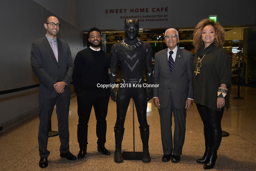 "Director Ryan Coogler, costume designer Ruth Carter, and executive producer Nate Moore pose with SAF Col. (Ret.) Charles McGee, Designated Original Tuskegee Airman before they present a special advance screening of ""Black Panther"" on Sunday, February 11 at the National Museum of African American History of Culture in Washington, D.C."