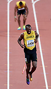 Great Britain, London - 2017 August 12: Usain Bolt of Jamaica pulls up during men's 4x100m relay final during IAAF World Championships London 2017 Day 9 at London Stadium on August 12, 2017 in London, Great Britain.<br /> <br /> Mandatory credit:<br /> Photo by &copy; Adam Nurkiewicz<br /> <br /> Adam Nurkiewicz declares that he has no rights to the image of people at the photographs of his authorship.<br /> <br /> Picture also available in RAW (NEF) or TIFF format on special request.<br /> <br /> Any editorial, commercial or promotional use requires written permission from the author of image.