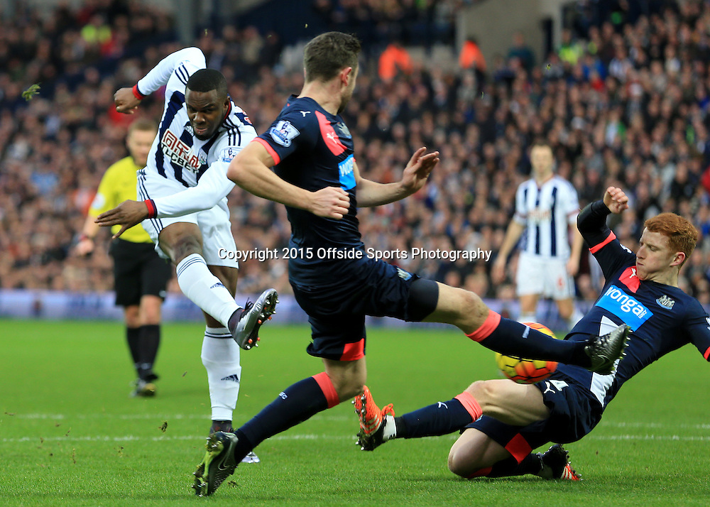 28th December 2015 - Barclays Premier League - West Bromwich Albion v Newcastle United - Victor Anicheebe of West Bromwich Albion shoots only to see it blocked by Jack Colback of Newcastle United - Photo: Paul Roberts / Offside.