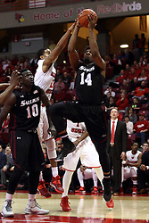 25 February 2015:   Jordan Caroline approaches the lane from the baseline with Deontae Hawkins attempting a block during an NCAA MVC (Missouri Valley Conference) men's basketball game between the Southern Illinois Salukis and the Illinois State Redbirds at Redbird Arena in Normal Illinois