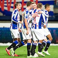 Voetbal Heerenveen Eredivisie 2014-2015 SC Heerenveen - Vitesse: Daley Sinkgraven (SC Heerenveen) ontvangt felicitaties van temagenoten na de 3-0