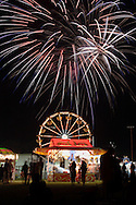 Warwick, NY - Fireworks explode in the night sky over carnival rides on June 28, 2008.