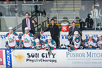 KELOWNA, CANADA - MARCH 27: Kris Mallette, assistant coach, Scott Hoyer, Athletic Therapist and Dan Lambert, head coach of the Kelowna Rockets stand on the bench against the Tri-City Americans on March 27, 2015 at Prospera Place in Kelowna, British Columbia, Canada.  (Photo by Marissa Baecker/Shoot the Breeze)  *** Local Caption *** Kris Mallette; Dan Lambert; Scott Hoyer;
