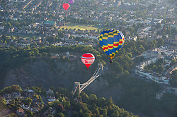 © Licensed to London News Pictures. 11/08/2018. Bristol, UK. Bristol International Balloon Fiesta. Balloons pass over the Avon Gorge and the Clifton Suspension Bridge during the morning mass ascent taking place on Saturday morning after the previous mass ascents were cancelled due to weather conditions, at the Bristol International Balloon Fiesta 2018 at Ashton Court estate which runs from Thursday 09 to Sunday 12 August. This year is the event's 40th anniversary and includes some special shape balloons that have not been seen for years, including Rupert the Bear, the giant motorbike, and the Scottish Piper. Photo credit: Simon Chapman/LNP