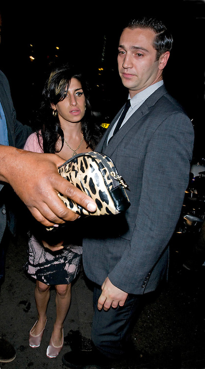 15.JUNE.2010. LONDON<br /> <br /> AMY WINEHOUSE AND REG TRAVISS LEAVE JAZZ AFTER DARK BAR, LONDON<br /> <br /> BYLINE: EDBIMAGEARCHIVE.CO.UK<br /> <br /> *THIS IMAGE IS STRICTLY FOR UK NEWSPAPERS AND MAGAZINES ONLY*<br /> *FOR WORLD WIDE SALES AND WEB USE PLEASE CONTACT EDBIMAGEARCHIVE - 0208 954 5968*