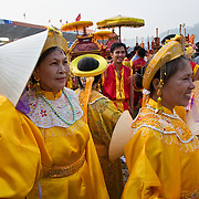 Women dressed in traditional costume join a procession for a fighting buffalo inside a stadium in Do Son, Vietnam, 27 September, 2009. Do Son, a popular beach-side town three hours east of Hanoi, plays host to an annual Buffalo Fighting Festival every autumn, with water buffalo and their entourage of farmers and trainers arriving from all over the mountainous north, where they have been in isolated training for months..The bulls are led into a football stadium and lock horns, the victor eventually chasing the vanquished out of the grounds to thunderous applauds from thousands of spectators, most of whom are betting heavily on the fights. The buffalo - both winners and losers - are then slaughtered outside the stadium, with their prize-fighting meat fetching up to $50 per kilogram for their owners.