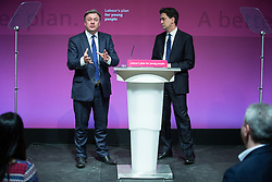 © Licensed to London News Pictures . 27/02/2015 . Leeds , UK . Ed Balls and Ed Miliband launch the Labour Party's fourth election pledge at a speech on young people . British Labour Party leader Ed Miliband and Shadow Chancellor Ed Balls at Leeds College of Music today ( Friday 27th February 2015 ) . Photo credit : Joel Goodman/LNP