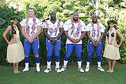 KO OLINA - FEBRUARY 11:  NFC Dallas Cowboys 2005 NFL Pro Bowl All-Stars (players left to right: Jason Witten #82, La'Roi Glover #97, Larry Allen #73, and Roy Williams #31) pose with Hawaiian Hula girls for their 2005 NFL Pro Bowl team photo on February 11, 2005 in Ko Olina, Hawaii. ©Paul Anthony Spinelli