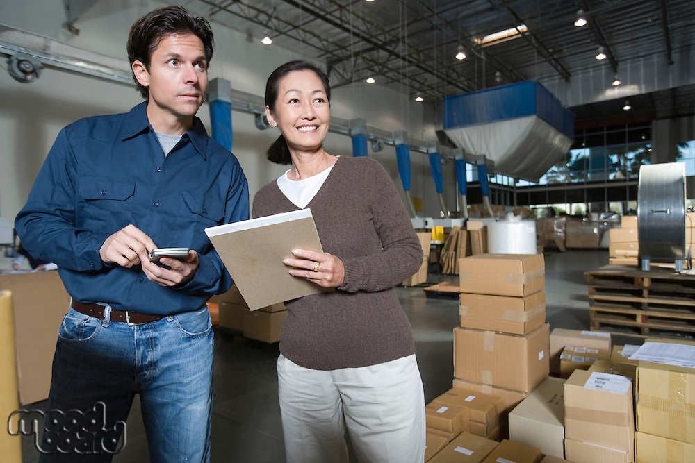 Man and woman in distribution warehouse