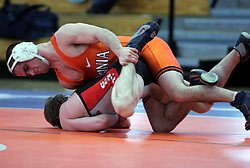 Anthony Burke drives Ohio State's Nathan Costello into the map in the 125 lb weight division match.  Burke won the match, but UVA fell 28-10 in the dual meet against OSU.